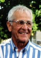 John R Szelog